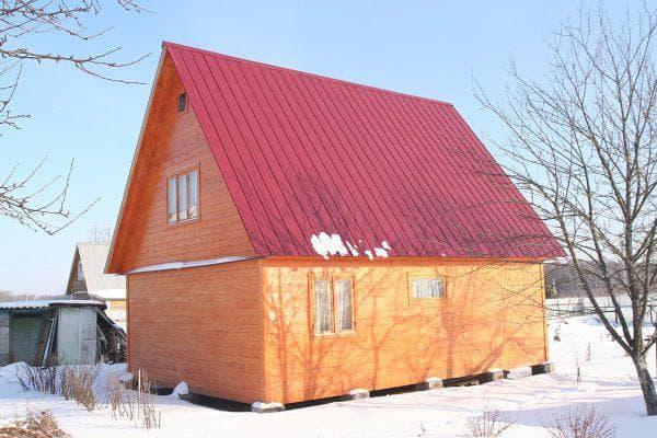 профнастил на деревянном доме